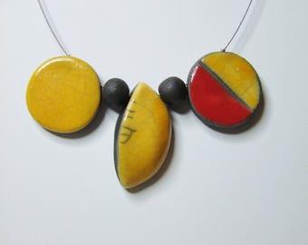 Yellow and red raku ceramic necklace.