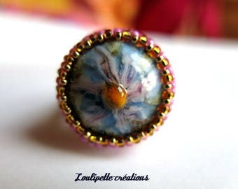 Embroidered ring and spun glass