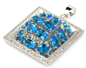 Sterling Silver Swiss Blue Topaz gemstone Pendant With AAA Cz Accents