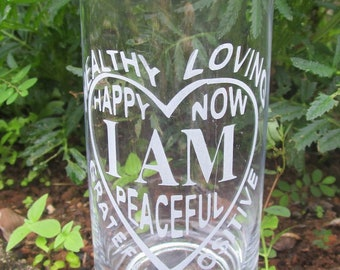 Tumbler with 8 positive affirmations sand blast etched into the surface.