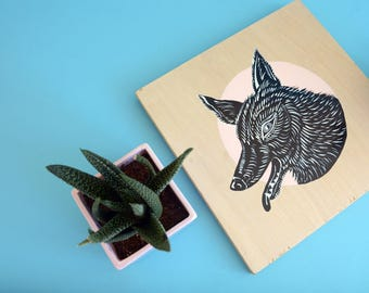Black and white Coyote painting on wood