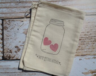 """25 Hand stamped muslin favor bags  5""""X7""""- jar with hearts and 'we're getting hitched' - perfect for showers, and other special occasions"""
