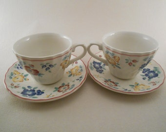 Pair of tea cups made by Churchill, Briar Rose pattern.  Made in Staffordshire England.
