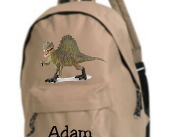 bag has beige dinosaur personalized with name