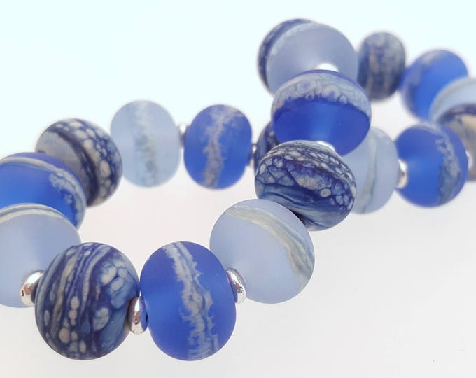 Featured listing image: Stretch Bracelet using my handmade marbled blue glass beads