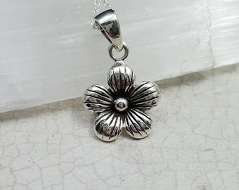 Tiny silver flower necklace. Small nature pendant. Sterling flower charm. Anemone necklace. Buttercup necklace. Gardener gift.Horticulturist