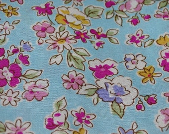 """Flowers"" pattern cotton fabric sky blue background"