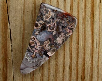 Flower Agate long triangle designer cabochon. 23 x 45 mm. High sheen polish in bronzy browns, pink and grey tones. 123L0086