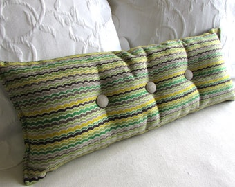 brightly colored decorative lumbar bolster pillow with buttons 9x25