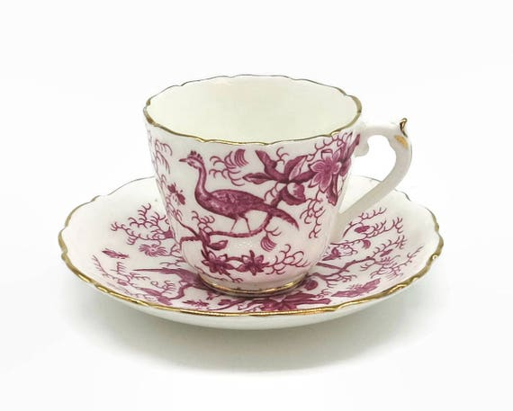 Vintage Coalport demitasse cup and saucer, pink and white Cairo pattern with birds, flowers, insects, gilt trim, 1970 - 74,