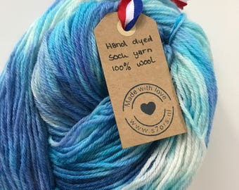 Hand dyed fine wool yarn in shades of blue and white.