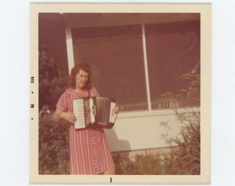 """Vintage Snapshot Photo: """"Ruth with her accordion that she can't play"""" 1973 [82649]"""
