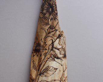 Woodburn flower art on up cycled, naturally, fallen wood.