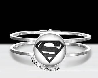"Superman Cuff Bracelet - Classic Comic Book Jewelry - Comic Superhero Accessory - Clark Kent Gift - DC Comics Geekery - 1"" Silver & Glass"