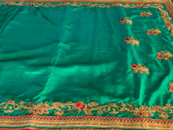 Dramatic green and red blouse bridal with embellished stitched saree qwrwE