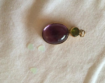 Amethyst pendant with gold ends