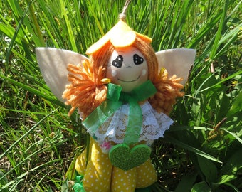 Fairy Orangina welcomes you. Cloth Doll. Decoration for the House, celebrates friendship, brings good luck.
