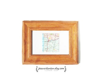 One Square Map Location in a Light Oak Frame