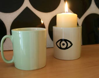 Hand painted white and green set of two mugs with eye pattern