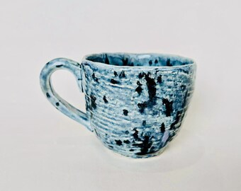 Hand built pottery tea cup