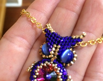 Beaded owl in purple and gold
