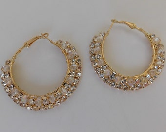 Golden earrings with white beads