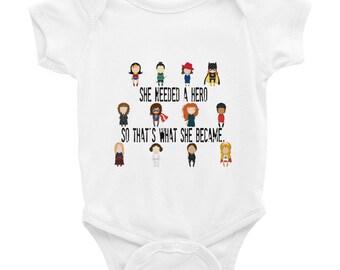 She Needed a Hero Infant Bodysuit
