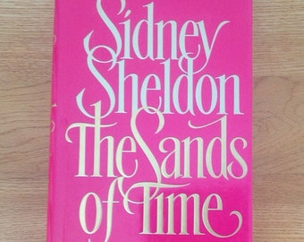 A vintage copy of The Sands of Time by Sidney Sheldon