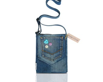 A unique denim jeans shoulder bag, fully lined, with front pocket and button detail.