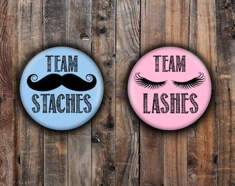 Lashes or Staches gender reveal pins.  Pink and Blue.