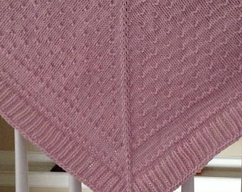 Very warm Aran weight 100 percent merino wool shawl with removable broach closure.