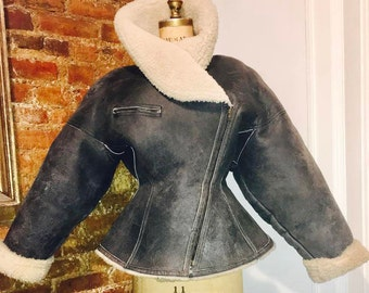 AZZEDINE ALAIA couture 1980 runway leather motorcycle bomber hourglass jacket one of a kind Made in France Museum historic