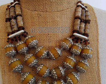 Multi strand silver repousse orange resin amber, carved jade necklace N170