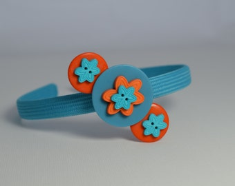 Turquoise blue headband featuring turquoise blue & orange flower button detachable barrette