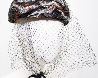 Stunning Feathered Hat with Veil.