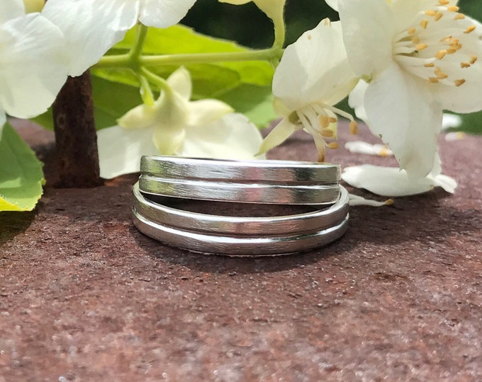Featured listing image: Rustic wedding band set - Wedding band set his and hers - Made to order - Handcrafted in ethically sourced sterling silver.
