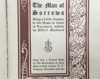 Antique leather book The Man of Sorrows by Elbert Hubbard, limp leather binding by the Roycrofters. Arts and Crafts decoration letterpress