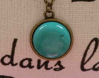 Brass color necklace with vintage look pendant