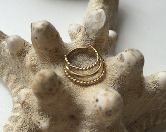 14 k solid gold septum jewelry triple ring with twisted wire