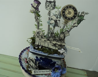 blue and white willow pot filled with alice and her friends