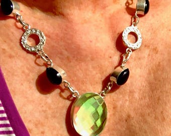 Dazzling aurora topaz and onyx in silver necklace