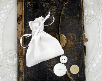 Fabric Bag With Twenty-Five Buttons- Shades of White