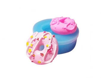 Miniature donut with sprinkles and Sauce Pan