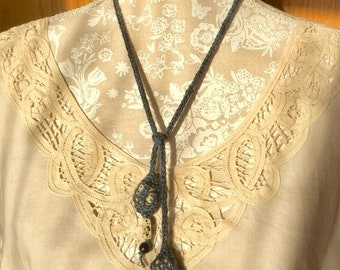 Dark Blue lariat style knitted necklace with Dalmatian Jasper stones and black beads