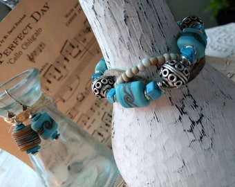 Beautiful Handmade Cream and Teal Lampwork, leather and Indonesian Seed Bead three stranded bracelet and earrings set!
