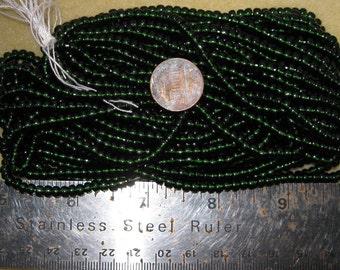 Czech Jablonex Ornela Preciosa seed beads, dark olivine, 6-ought, 4mm, full hank, dark green, temporarily strung