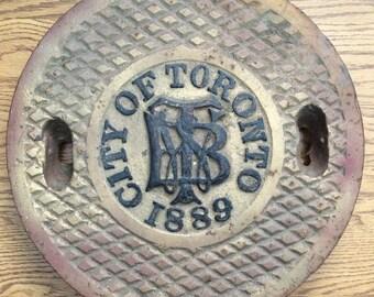 Antique manhole cover Toronto 1889
