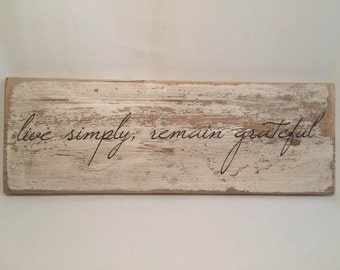 Wooden rustic quote sign. Live simply, remain grateful. Rustic, natural, home decor.