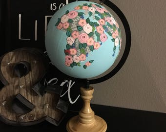 Medium hand painted World Globe with blue background and foowers