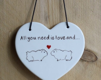 Hanging Ceramic Guinea Pig Heart - 'All you need is love and...'